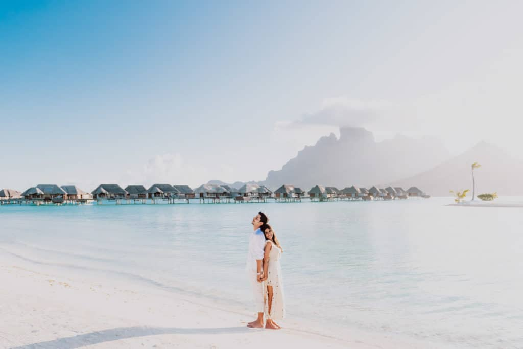 couple photoshoot at the Four Seasons Bora Bora main beach sunset