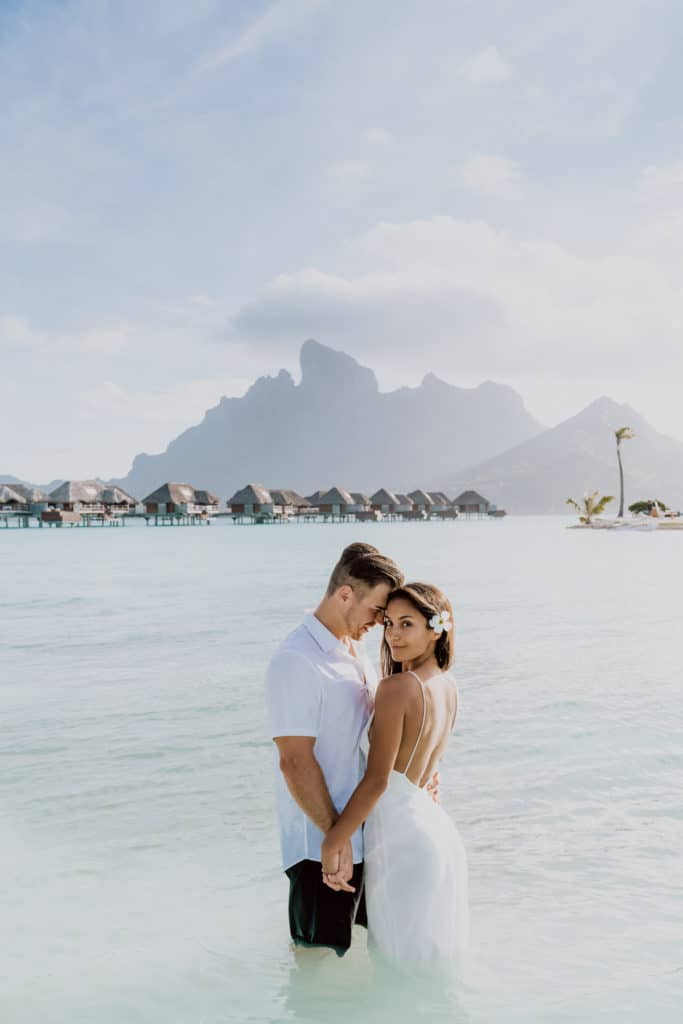 couple photoshoot at the Four Seasons Bora Bora main beach