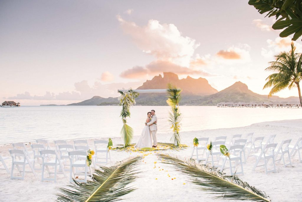 Sunset wedding ceremony at the Four Seasons Bora Bora