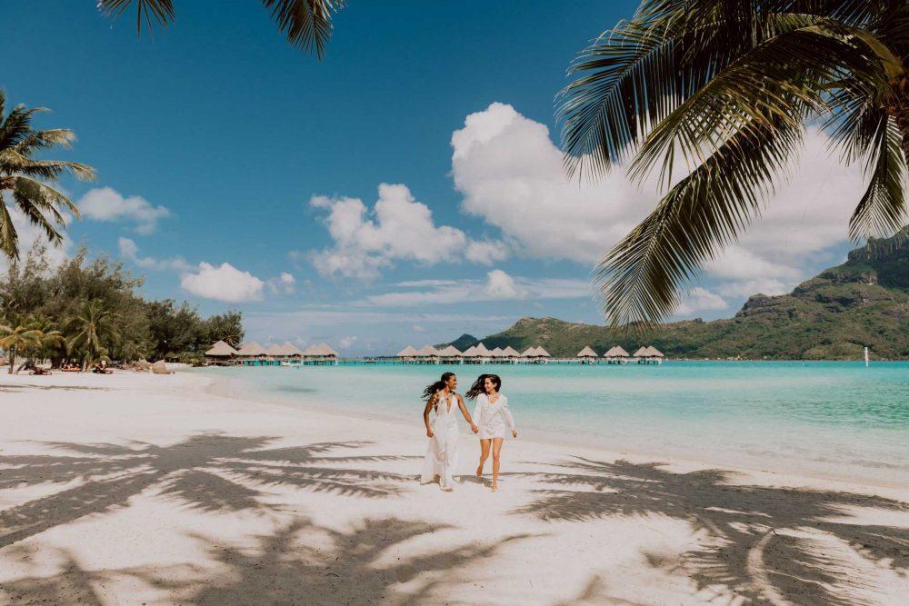 Lesbian couple on Bora Bora beach