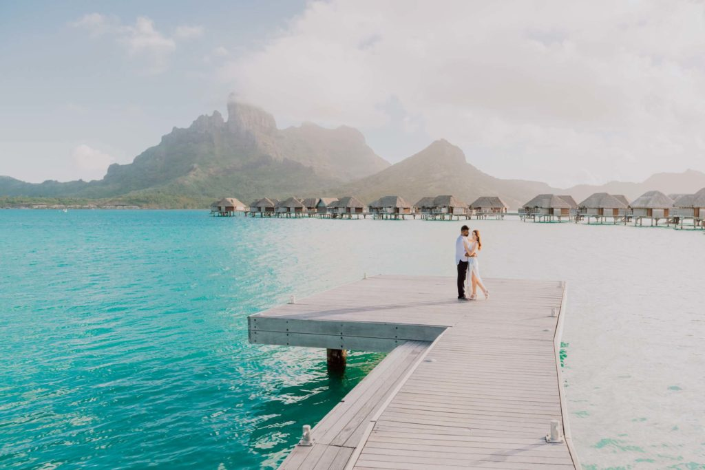 photoshoot at the Four Seasons Bora Bora main dock at sunset